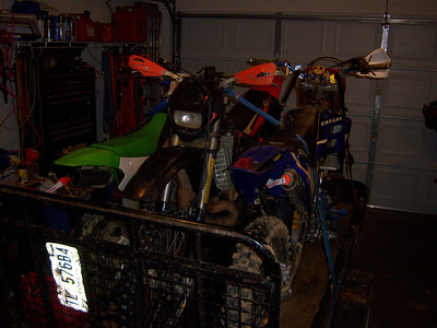3 Dirt bikes on trailer