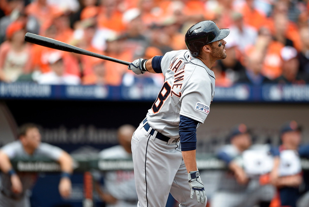 . Detroit Tigers\' J.D. Martinez watches his three-run home run in the fourth inning of Game 2 in baseball\'s AL Division Series against the Baltimore Orioles in Baltimore, Friday, Oct. 3, 2014. (AP Photo/Nick Wass)