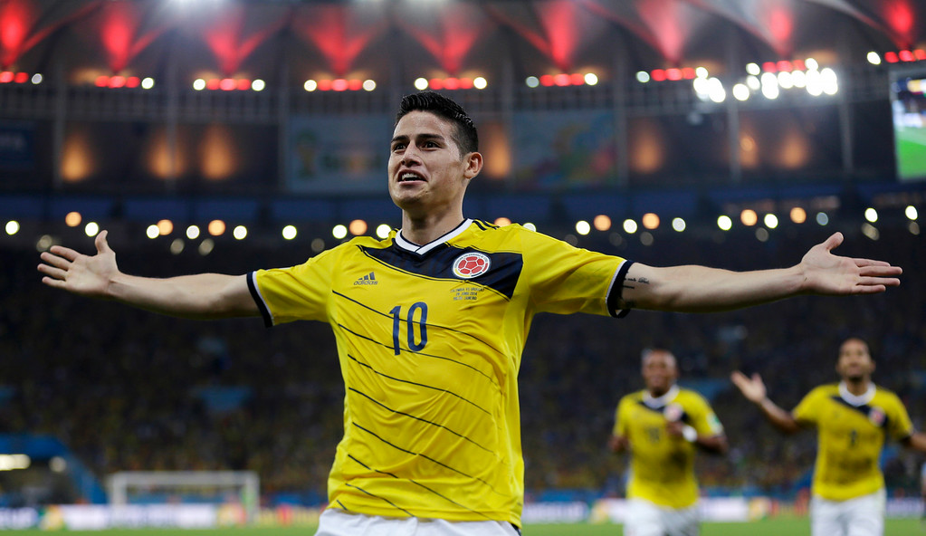 . Colombia\'s James Rodriguez celebrates after scoring the opening goal during the World Cup round of 16 soccer match between Colombia and Uruguay at the Maracana Stadium in Rio de Janeiro, Brazil, Saturday, June 28, 2014. (AP Photo/Natacha Pisarenko)