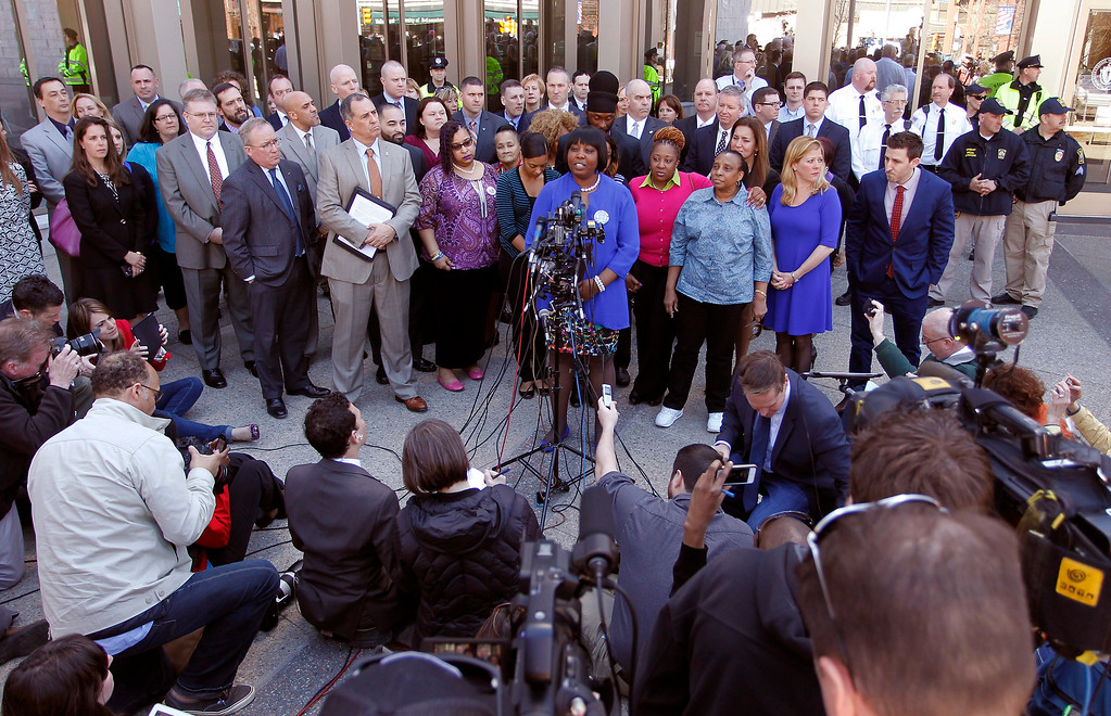 . Ursula Ward, at the podium, mother of shooting victim Odin Lloyd, is surrounded by family, friends and attorneys, as she speaks with the media outside Bristol County Superior Court Wednesday, April 15, 2015, in Fall River, Mass., after former New England Patriots football player Aaron Hernandez was found guilty of murder in the shooting death of Odin Lloyd. Hernandez was sentenced to life in prison. (AP Photo/Stew Milne)