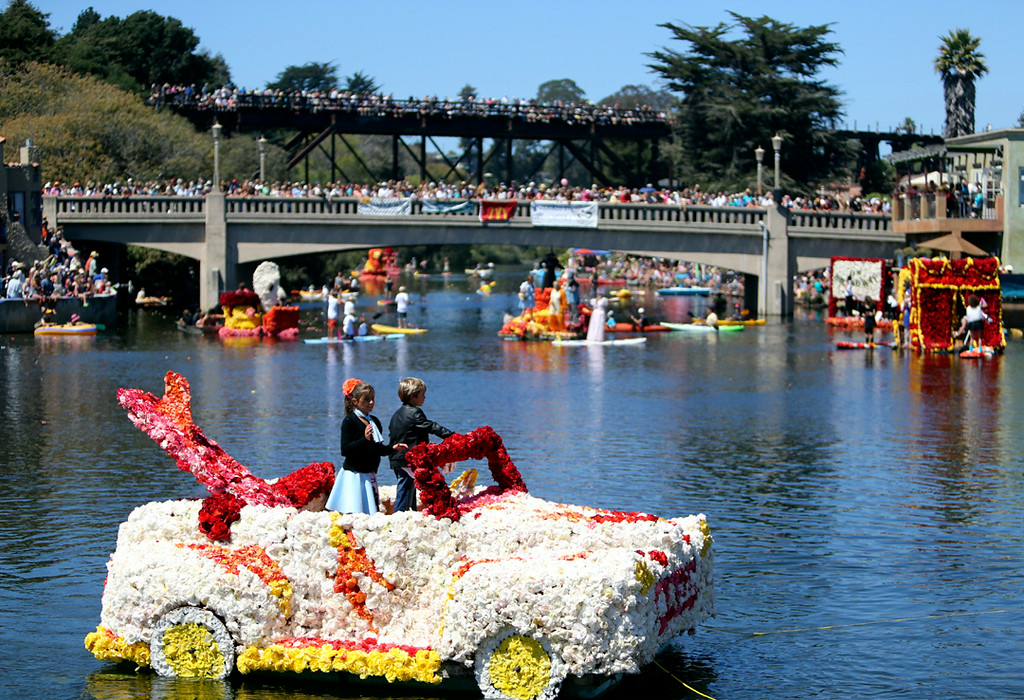 . Floats decorated in thousands of begonias circle through Capitola Beach on Sunday. (Kevin Johnson -- Santa Cruz Sentinel)