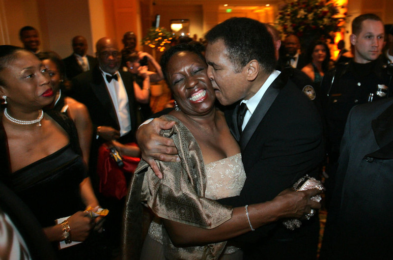 . Muhammad Ali, right, stops to give a hug to fan Martha Thomas as he arrives for the Butterfly Ball, a tribute in his honor, coinciding with Black History Month, Saturday Feb. 26, 2005, in Atlanta. (AP Photo/John Amis)