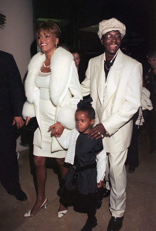 . One of the world\'s most popular US singer Whitney Houston, her husband, US singer Bobby Brown and their daughter Bobbi Kristina, arrive 11 October 1998 at the International Achievement in Arts Awards in Beverly Hills. Houston and Brown married in 1992.  (LUCY NICHOLSON/AFP/Getty Images)