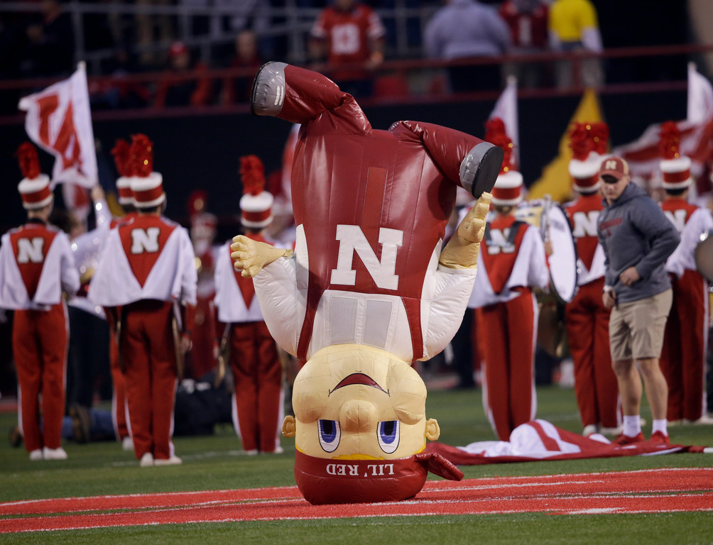 . Nebraska mascot Lil\' Red stands on his head before an NCAA college football game against Ohio State in Lincoln, Neb., Saturday, Oct. 14, 2017. Ohio State won 56-14. (AP Photo/Nati Harnik)