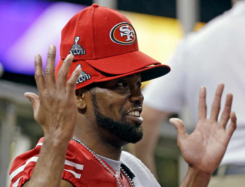 . San Francisco 49ers wide receiver Randy Moss wears multiple hats during media day for the NFL Super Bowl XLVII football game Tuesday, Jan. 29, 2013, in New Orleans. (AP Photo/Mark Humphrey)