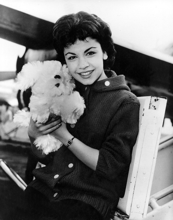 . Walt Disney studio\'s new star, 16-year-old  Annette Funicello, poses with her Shaggy Dog doll, at Idlewild Airport in New York, on March 24, 1959.  (AP Photo)