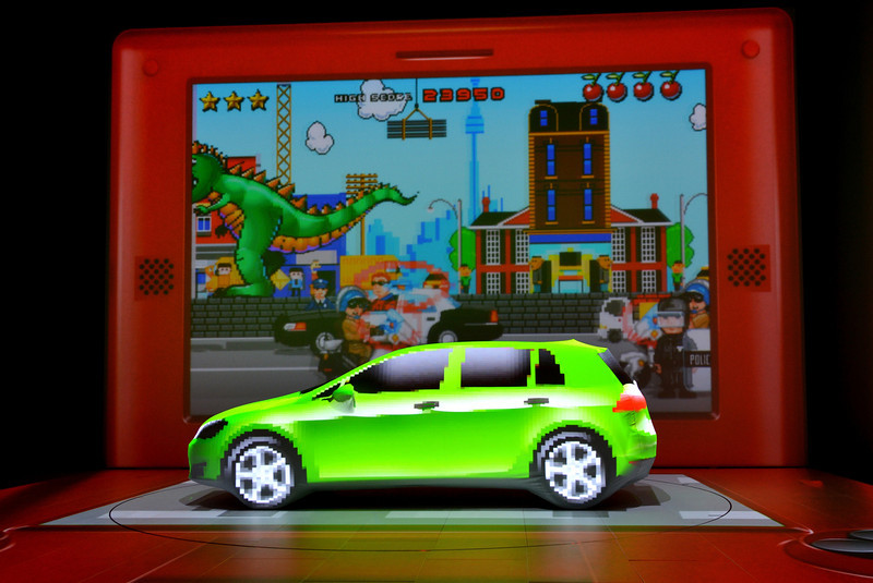 . A multimedia display projected onto a screen and a cover on the Volkswagen Golf during the first press preview day at the New York International Automobile Show March 27, 2013 in New York.  STAN HONDA/AFP/Getty Images