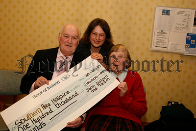 John Dalzell and his team raise £100.000 for Hospice, John Dalzell presents a cheque for £100.000 to Sister Clare and Joanne Lindsey-Martin of the Newry Hospice from his Christmas sit-out,07W7N51