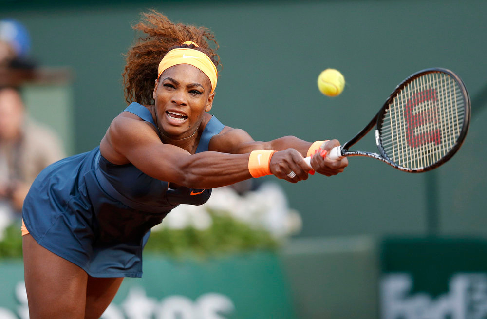. Serena Williams of the U.S. hits a return to Caroline Garcia of France during their women\'s singles match at the French Open tennis tournament at the Roland Garros stadium in Paris May 29, 2013.    REUTERS/Gonzalo Fuentes