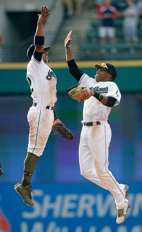 . Cleveland Indians\' Francisco Lindor, left, and Greg Allen celebrate after the Indians defeated the Chicago White Sox 9-6 in a baseball game, Monday, May 28, 2018, in Cleveland. (AP Photo/Tony Dejak)