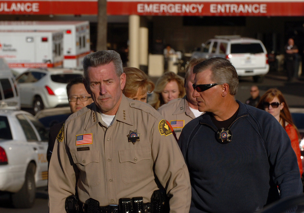 . San Bernardino County Sheriff John McMahon, left, walks away from the  Loma Linda University Medical Center emergency room to report to the media that one of his deputies, Jeremiah McKay, was killed and another injured during a shootout with Christopher Dorner in the Big Bear area February 12, 2013. (Staff photo by Thomas R. Cordova/Inland Valley Daily Bulletin)