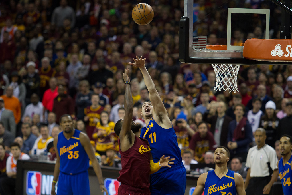 . Kyrie Irving (2) of the Cleveland Cavaliers goes up for a lay up against the Warriors\' Klay Thompson (11) during an NBA game at the Quicken Loans Arena on Christmas day.  The Cavs defeated the Warriors 109-108.  Michael Johnson - The News Herald