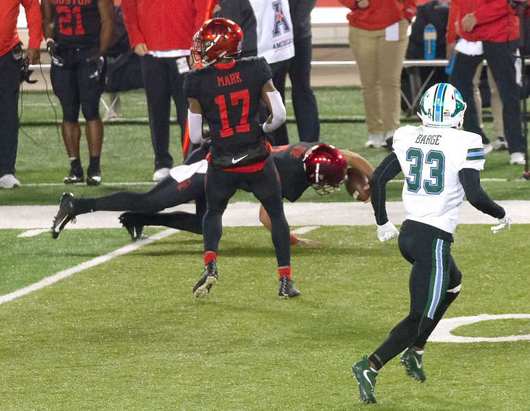 UH player Justice lunges to the Tulane 26 yard line.