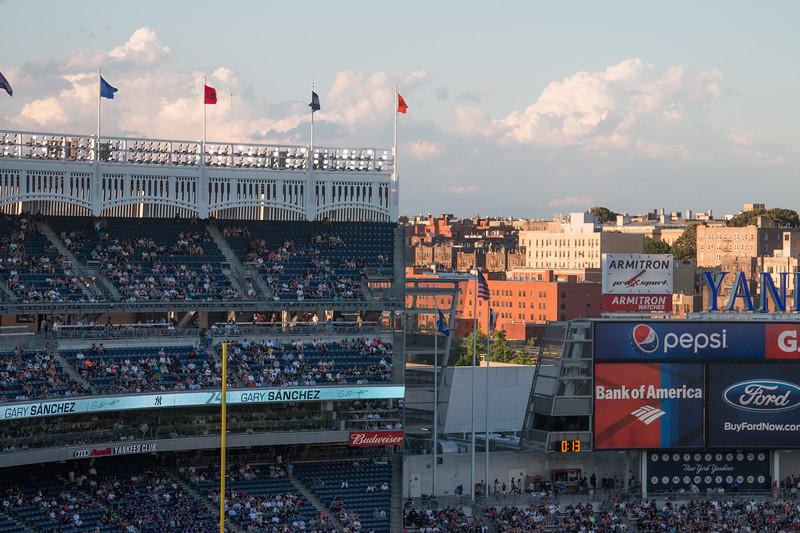 Stadium and neighboring buildings at dusk -- Yankee Stadium, the Bronx, NYC