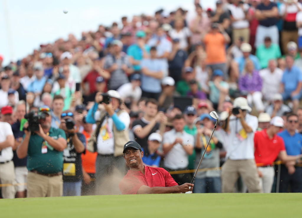 . Tiger Woods of the US plays out of a bunker on the 8th hole during the final round of the British Open Golf Championship in Carnoustie, Scotland, Sunday July 22, 2018. (AP Photo/Peter Morrison)