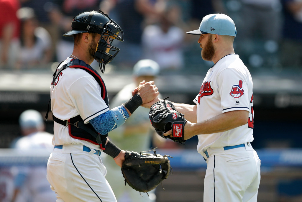 . Cleveland Indians catcher Yan Gomes, left, congratulates relief pitcher Cody Allen after the Indians defeated the Minnesota Twins 4-1 in a baseball game, Sunday, June 17, 2018, in Cleveland. (AP Photo/Tony Dejak)