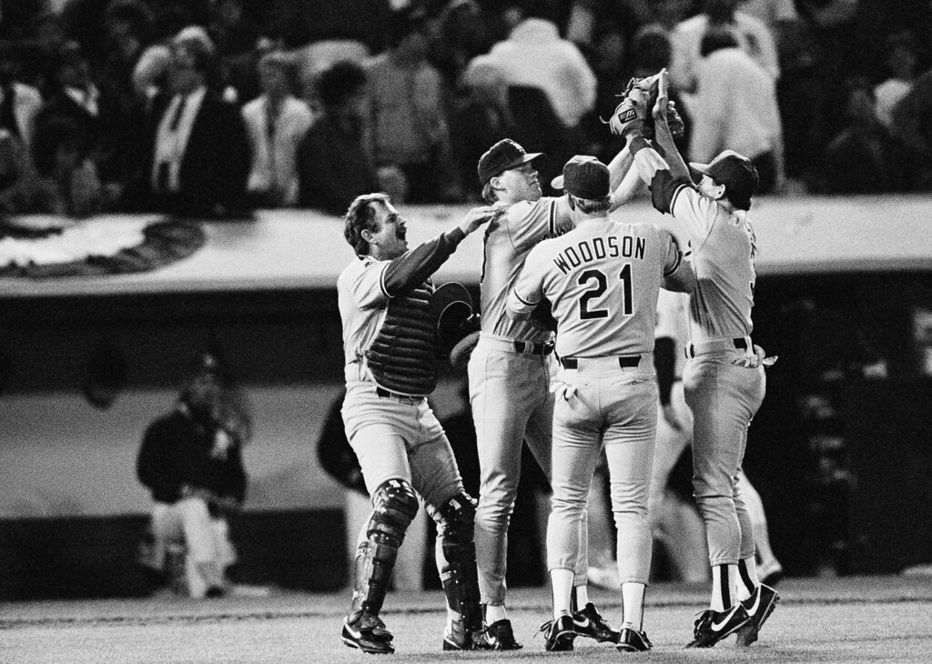. Los Angeles Dodgers relief pitcher Jay Howell, second from left, is mobbed by teammates after recording a save in the Dodgers 4-3 win over the Oakland A\'s in the fourth game of the World Series, Oct. 19, 1988 in Oakland. From left are Dodgers catcher Rick Dempsey, Howell, Tracy Woodson and Steve Sax. (AP Photo/John Swart)