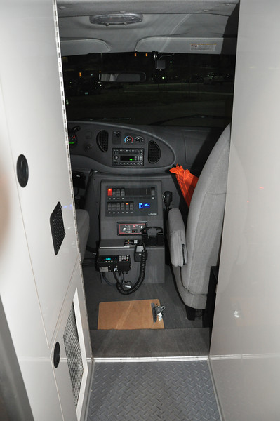 This is a view from the rear work area through a small walk through to the front seats. The control panel operates the emergency lights, starts the generator and the master switch for the power in the work area is all located on the panel. The switch I for the aux battery is also located on this panel.