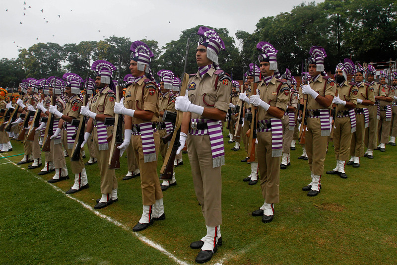 . Jammu and Kashmir policemen participate in a parade to mark India\'s Independence Day in Srinagar, India, Thursday, Aug. 15, 2013. (AP Photo/Mukhtar Khan)