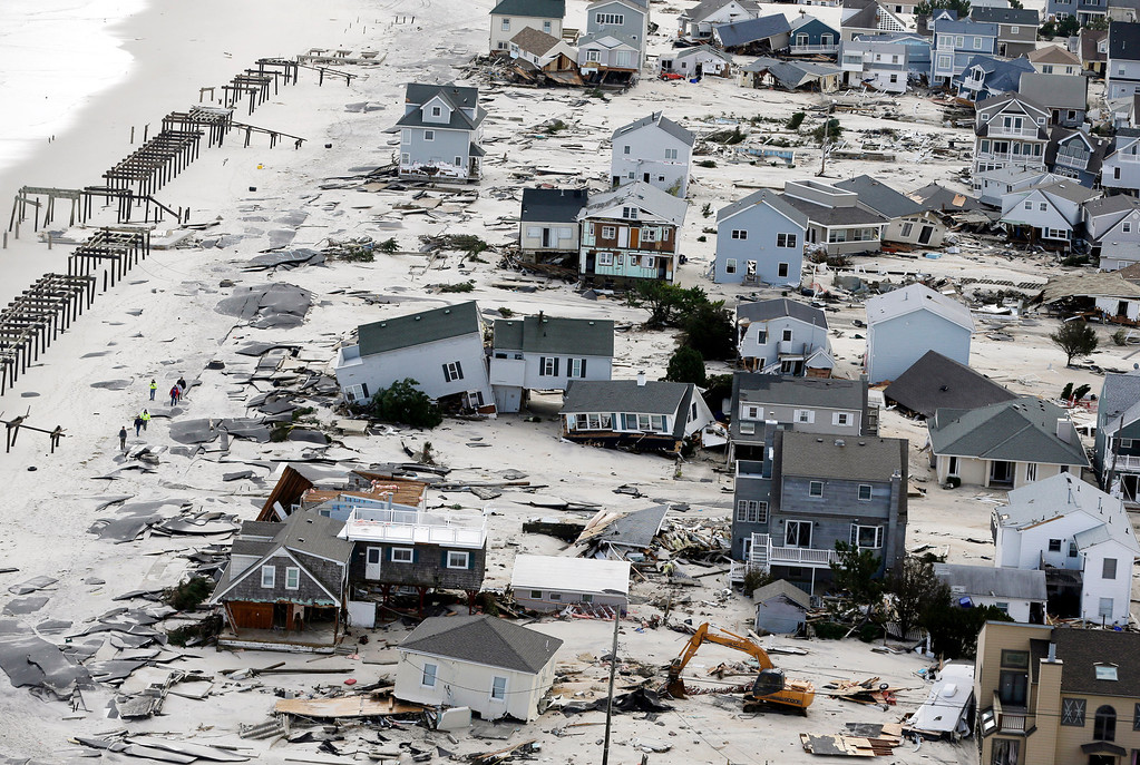 . This Oct. 31, 2012 aerial file photo shows destruction in the wake of Superstorm Sandy in Seaside Heights, N.J.   (AP Photo/Mike Groll, File)