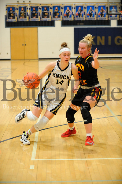 Knoch #14 Neveah Ewing drives for the backset past North Catholic #23 Tess Myers during a game at Knoch Gym on Monday January 13, 2020 (Jason Swanson photo)