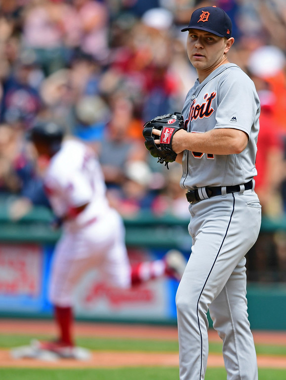 . Detroit Tigers relief pitcher Artie Lewicki waits for Cleveland Indians\' Jose Ramirez to run the bases after hitting a solo home run in the sixth inning of a baseball game, Sunday, June 24, 2018, in Cleveland. The Indians won 12-2. (AP Photo/David Dermer)