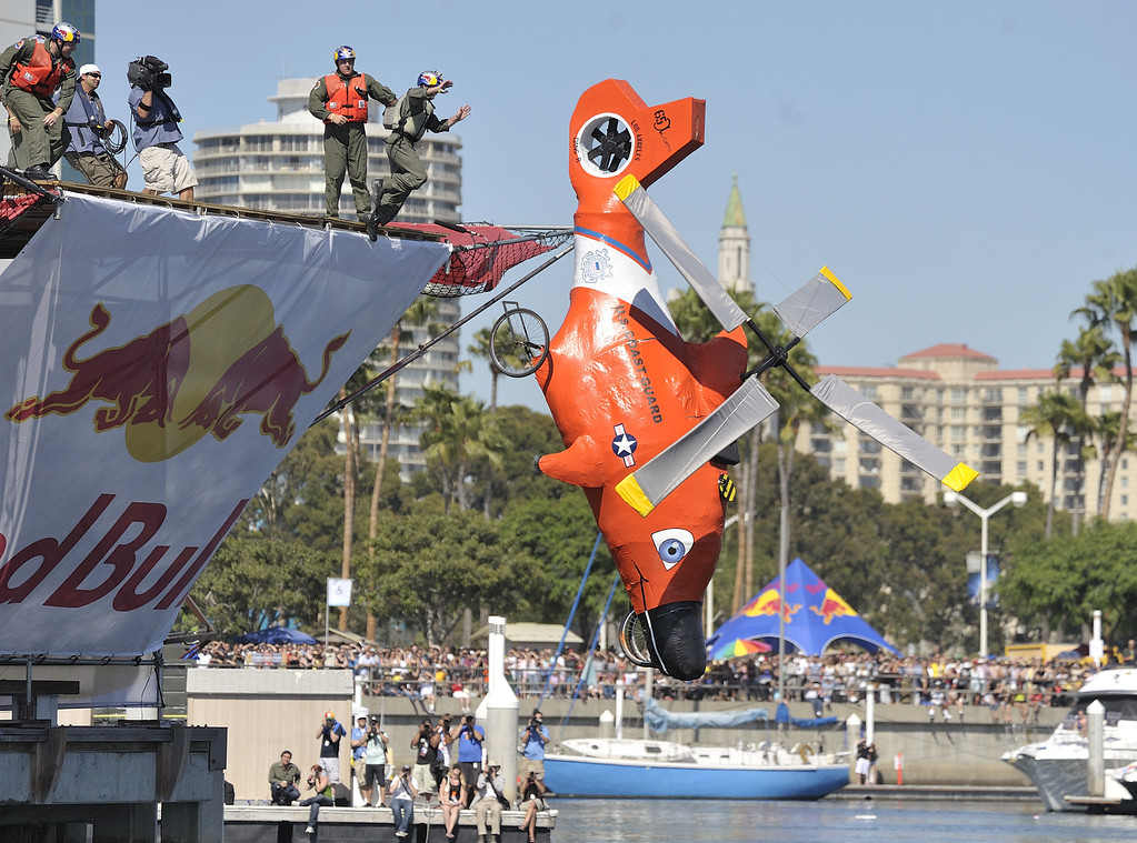 """. LONG BEACH, CALIF. USA -- Flugtag entry \""""Team Coast Guard\"""" in Rainbow Harbor in Long Beach, Calif. on August 21, 2010. Thirty five teams competed in the Red Bull event where teams build homemade, human-powered flying machines and pilot them off a 30-foot high deck in hopes of achieving flight.  Flugtag means \""""flying day\"""" in German. They are on distance, creativity and showmanship..Photo by Jeff Gritchen / Long Beach Press-Telegram.."""