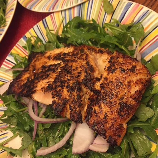 On the table tonite: grilled salmon over arugula