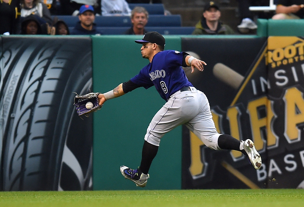 . PITTSBURGH, PA - MAY 21:  Gerardo Parra #8 of the Colorado Rockies fields a ball on a single hit by Jordy Mercer #10 of the Pittsburgh Pirates (not pictured) during the eighth inning  on May 21, 2016 at PNC Park in Pittsburgh, Pennsylvania.  (Photo by Joe Sargent/Getty Images)