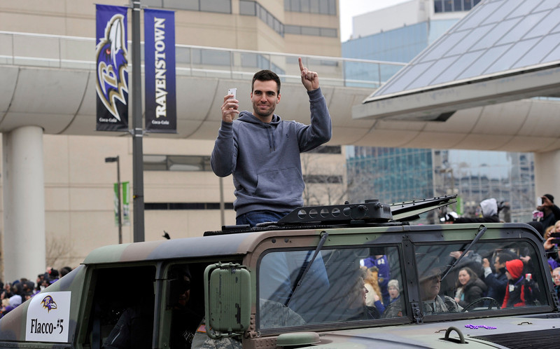 . Baltimore Ravens quarterback and Super Bowl MVP Joe Flacco gestures while riding in a Humvee during the Ravens victory parade Tuesday, Feb. 5, 2013, in Baltimore. The Ravens defeated the San Francisco 49ers in NFL football\'s Super Bowl XLVII 34-31 on Sunday. (AP Photo/Gail Burton)