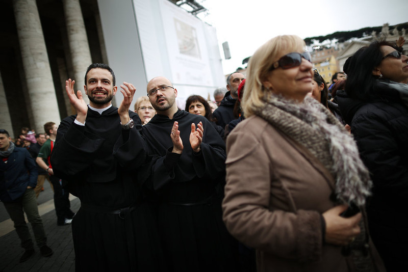 . Priests (L) applaud in St Peter\'s Square as Pope Francis gives his first Angelus blessing on March 17, 2013 in Vatican City, Vatican. The Vatican is preparing for the inauguration of Pope Francis on March 19, 2013 in St Peter\'s Square.  (Photo by Peter Macdiarmid/Getty Images)