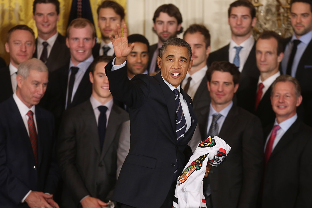 . U.S. President Barack Obama waves goodbye after celebrating the 2013 National Hockey League champion Chicago Blackhawks in the East Room of the White House November 4, 2013 in Washington, DC.  (Photo by Chip Somodevilla/Getty Images)