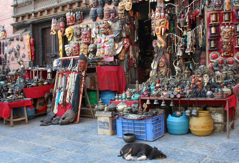 stuff for sale with guard dog.  swayambhunath stupa.  kathmandu