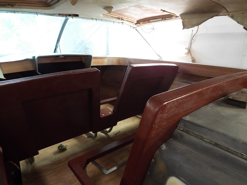 Front and middle seats reassembled after being painted and installed in the boat.