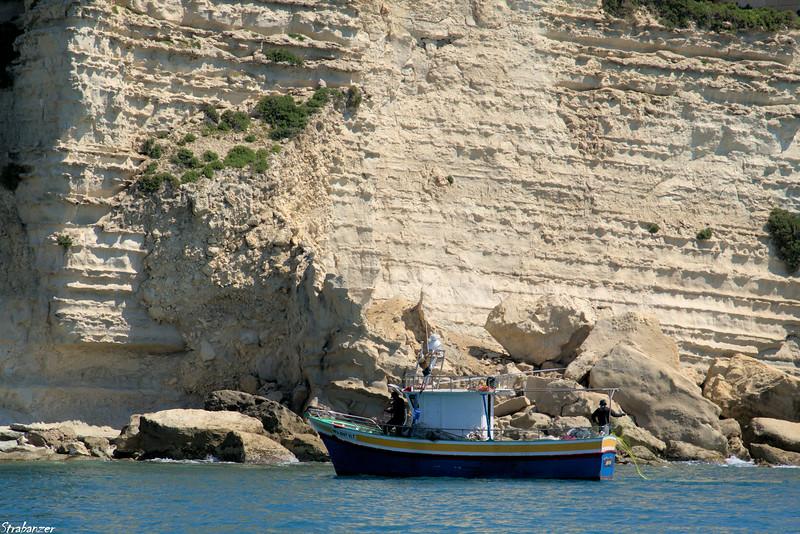 Malta.   Marsaxlokk Harbor    Cliffs near Belvedere Il-Kalanka     03/24/19.     This work is licensed under a Creative Commons Attribution- NonCommercial 4.0 International License