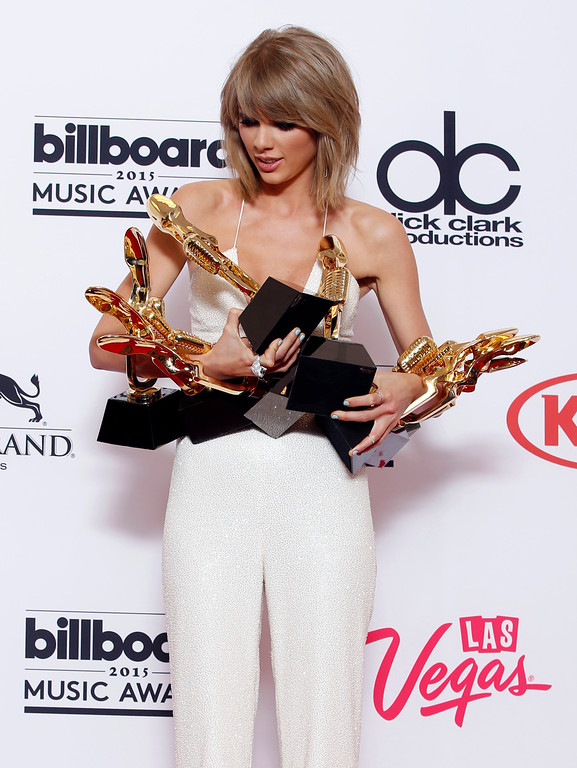 ". Taylor Swift poses in the press room with the awards for top Billboard 200 album for ""1989,\"" top female artist, chart achievement, top artist, top Billboard 200 artist, top hot 100 artist, top digital song artist, and top streaming song (video) for \""Shake It Off\"" at the Billboard Music Awards at the MGM Grand Garden Arena on Sunday, May 17, 2015, in Las Vegas. (Photo by Eric Jamison/Invision/AP)"