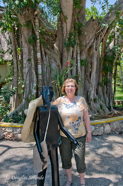 Louise and friend in front of a banyan tree at a cenote in the Yucatan
