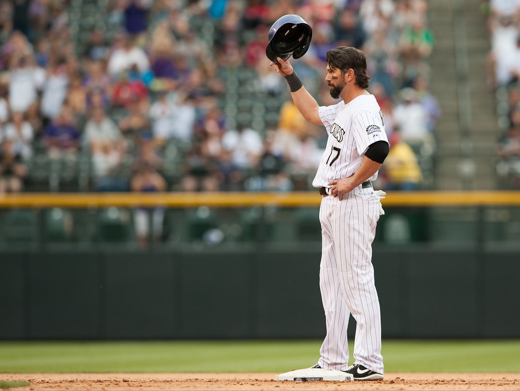 . Todd Helton #17 of the Colorado Rockies tips his hat to acknowledge cheers after it was announced that the two runs he knocked in with a fifth inning double resulted in Helton\'s 1400th RBI against the Arizona Diamondbacks at Coors Field on September 22, 2013 in Denver, Colorado.  (Photo by Dustin Bradford/Getty Images)