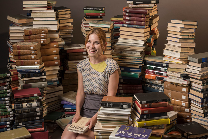 International Languages Literatures and Cultures Department (ILLC) faculty Friederike Fichtner has a portrait taken in the midst of 1000 books as part of the new faculty portraits photographed in the studio on Tuesday, August 15, 2017 in Chico, Calif. (Jason Halley/University Photographer)
