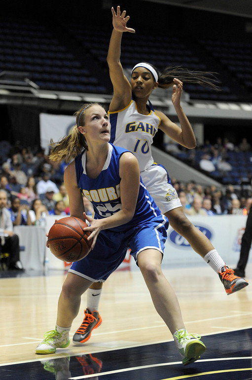 . Agoura #25 Emma Freidl gets past Gar #10 Ra\'Vyn Bowser. Agoura defeated Gahr 60-39 in the CIF-SS Division III-AAA Girls Basketball Championship at the Anaheim Convention Center in Anaheim, CA 2/23/2013(John McCoy/Staff Photographer)