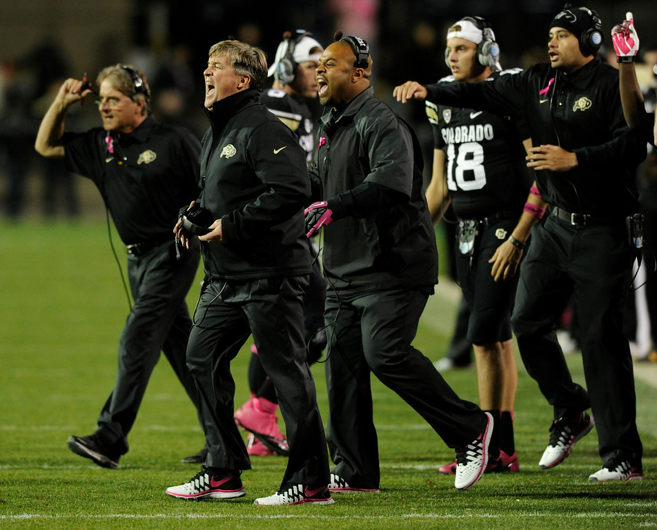 . BOULDER, CO. - OCTOBER 26: Colorado coach Mike MacIntyre and assistants came out onto the field when they saw something they didn\'t like in the second half. The University of Colorado football team hosted Arizona Saturday night, October 26, 2013. Photo By Karl Gehring/The Denver Post