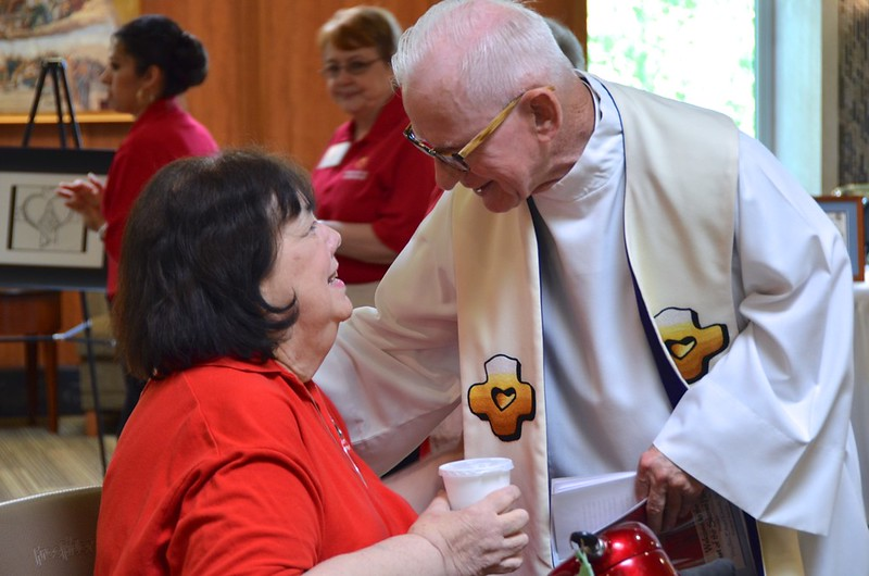 Fr. John greets one of our staff