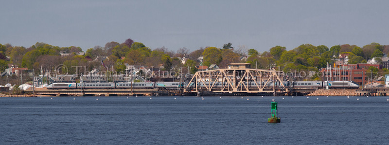Acela over Shaws A westbound Amtrak Acela crosses over the Shaw's Cove Swing Bridge in New London, CT
