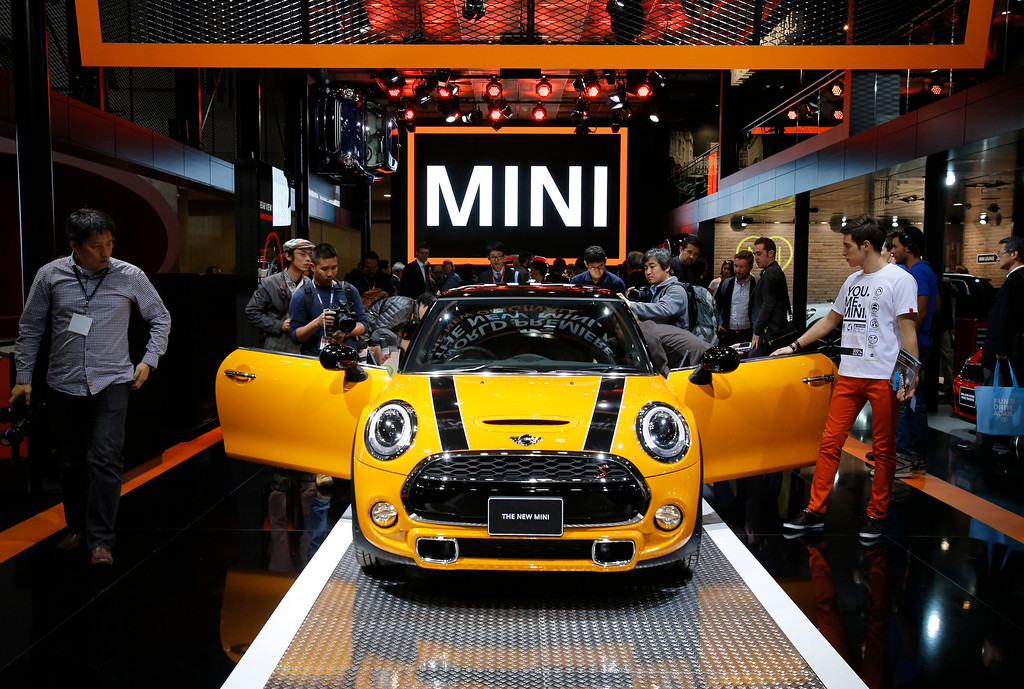 . A new Mini is displayed at the media preview for the Tokyo Motor Show at Tokyo Big Sight in Tokyo, Wednesday, Nov. 20, 2013. The biannual exhibition of vehicles in Japan runs for the public from Saturday, Nov. 23 through Dec. 1. (AP Photo/Shuji Kajiyama)