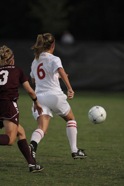 Tina Frost (6) defends her side of the field.