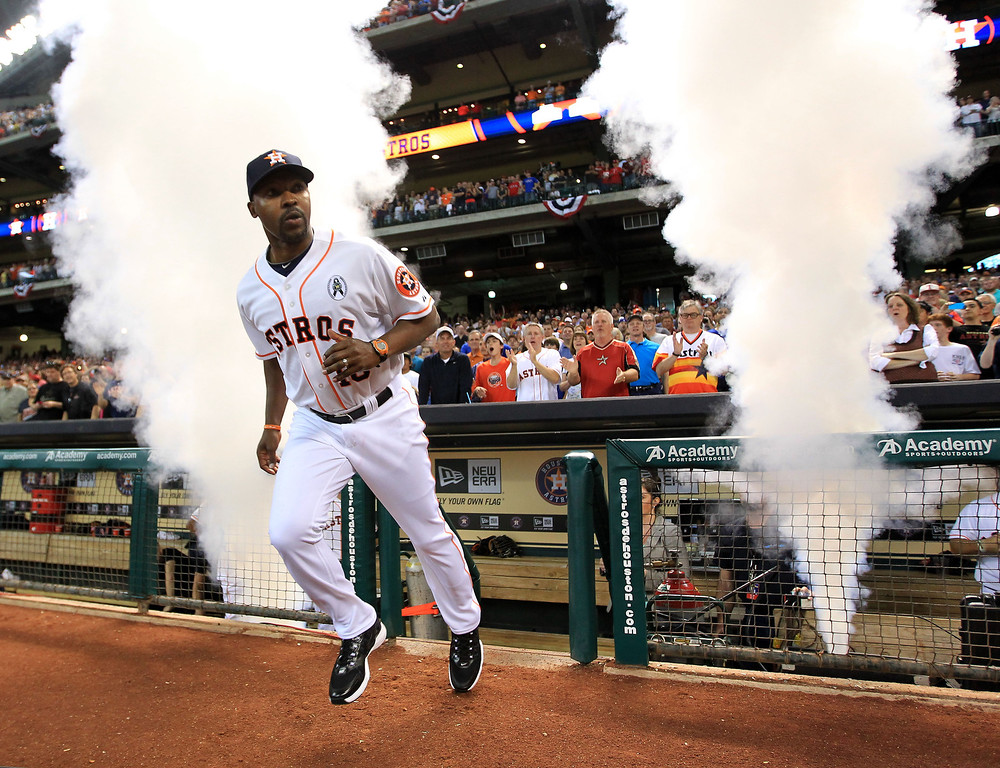 . Houston Astros manager Bo Porter (16) runs out during player introductions before a season-opening baseball game against the Texas Rangers at Minute Maid Park, Sunday, March 31, 2013, in Houston. (AP Photo/Houston Chronicle, Karen Warren)