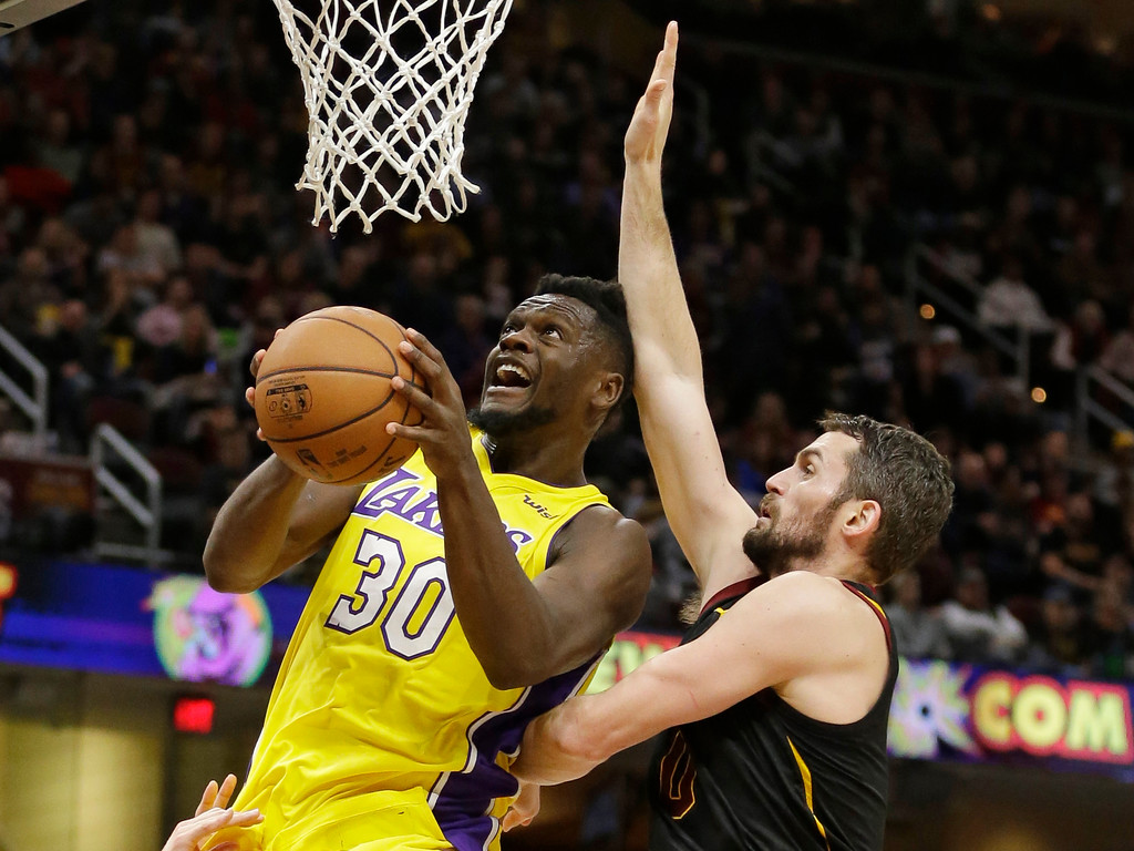 . Los Angeles Lakers\' Julius Randle (30) drives to the basket against Cleveland Cavaliers\' Kevin Love (0) in the second half of an NBA basketball game, Thursday, Dec. 14, 2017, in Cleveland. (AP Photo/Tony Dejak)