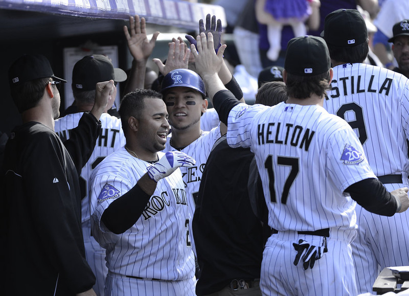 . Colorado Rockies Wilin Rosario (20) is congratulated by teammates in the dugout after his three run home run in the seventh inning against the San Diego Padres April 7, 2013 at Coors Field. (Photo By John Leyba/The Denver Post)