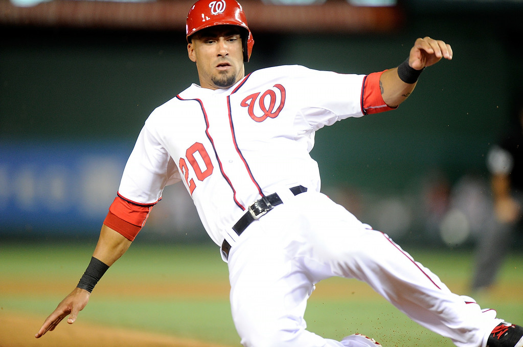 . WASHINGTON, DC - JUNE 30: Ian Desmond #20 of the Washington Nationals steals third base in the sixth inning against the Colorado Rockies at Nationals Park on June 30, 2014 in Washington, DC.  (Photo by Greg Fiume/Getty Images)