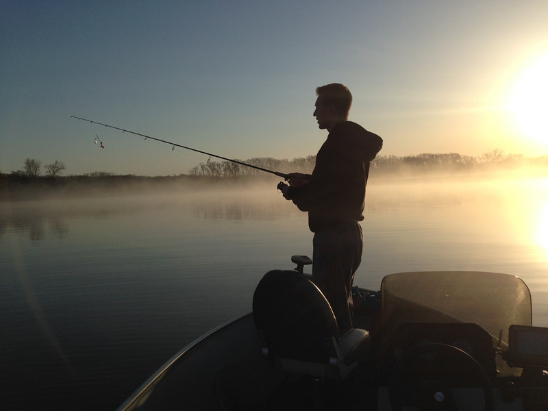 ". Alex Zell, 17, of Lakeville prepares to take the first cast of the season May 10 on Orchard Lake. His father Jerry Zell reports: ""No fish to report but this picture captured the excitement and beauty of the opener!\"" (Photo courtesy Jerry Zell)"